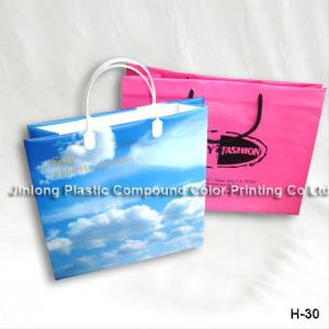 China Color Printed Glossy Finishing Carrier Plastic Gift Bags, Plastic Handle Bags on sale