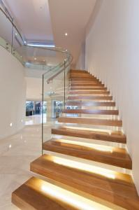 China Clear glass railing floating stair with Led light on sale