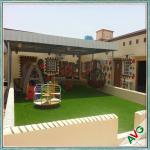 China Warm Green Color Soft Hand feeling but Strong Dence Turf Surface for Play Ground wholesale