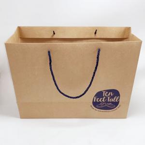 China Recycled Kraft Paper Bags Custom Printed Paper Gift Bags With Nylon Rope on sale