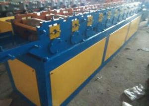 China Saw Cutting Shutter Door Roll Forming Machine 1 Inch Chain Stable Transmission on sale
