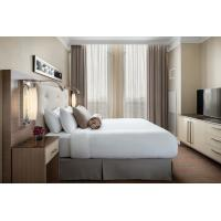 China laminated Oak wood Hotel bedroom Furniture sets Tall headboard with Fabric upholstered padded and TV units Contemporary on sale