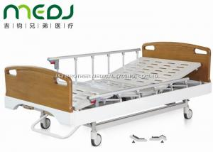 China Critical Care Manual Hospital Bed , Wood Foldable Hospital Bed With Central Brakes on sale