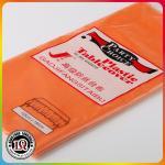 Paño plástico redondo anaranjado de la cubierta de tabla