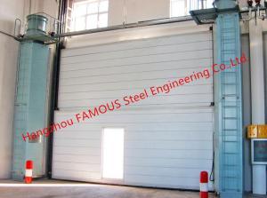 China Segmental Overhead Steel Doors Vertical Lifting Counterweight Sectional Industrial Doors on sale