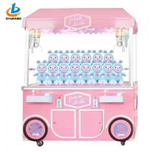 China Coin Operated Pink Arcade Claw Machine Milk Doll Car Two Insert Slot on sale