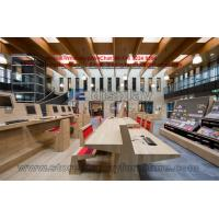 Centre library Furniture design by oak wood counters and bookcase shelves with fabric bench
