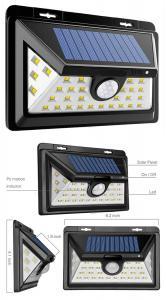 China Outdoor Wall Solar Energy Solar Powered Fence Motion Sensor Home Garden Led Solar Light on sale