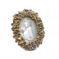 China Environmentally Antique Oval Gold Picture Frames With Petal Leaf Waved Twist Border on sale