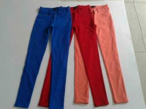 China 17000pcs overstock women brand surplus skinny pants, slim fitting trousers lots inventory on sale