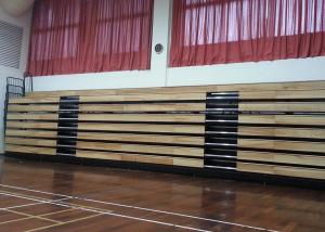 China Motorized Retractable Gym Seating Wooden Bench For Multi - Functional Hall on sale