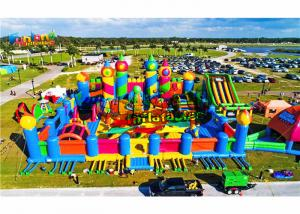 China Giant Outdoor Rainbow Castle Theme 1500W Inflatable Fun Land on sale