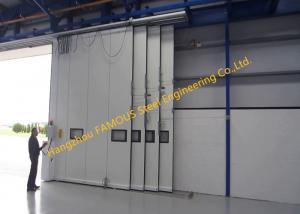 China Multi Sector Structural Folded Hinged Sliding Doors Bottom Rolling Hangar Door Smart Track Design on sale