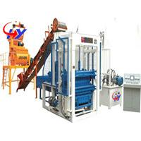 Concrete block laying machines