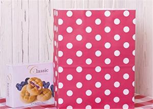 China L'emballage de papier de points rouges met en sac avec le sac à provisions de pouce des sacs 8x4.75x10.5 de cadeau de poignée on sale