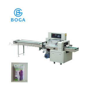 China Horizontal Flow Wrap Machine Semi Automatic Film Wrapping Latex Glove Packing on sale