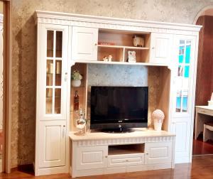 Astounding White Wooden Tv Stand With Showcase Glass Door Corner Tv Creativecarmelina Interior Chair Design Creativecarmelinacom