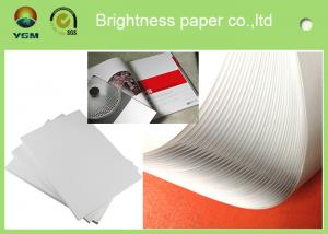 China Good Smoothness White Glossy Art Paper Couch Paper Roll For Printing Magazines on sale