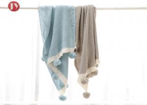 China 100% Cotton Organic Warm Baby knit Blanket Muslin Swaddle Baby Pom Pom throw on sale