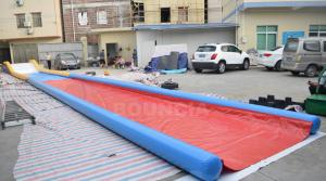 China 27m Long Air Sealed Inflatable Water Slides For Lakeside / Inflatable Slip N Slide on sale
