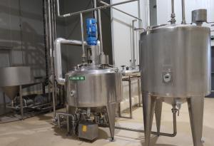 China 1000kg/H Condensed Milk Plant / Fresh Milk Processing With 380g Tin Can Packages on sale