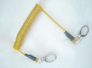 China Yellow coil steel lanyard with end fittings high quality retracting coil cable with oval h on sale