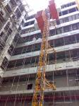 El material de construcción seguro pintado rojo de encargo alza SC200/200 para el constructor