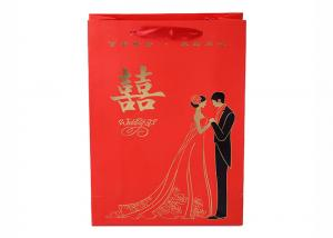 China Gold Foil Logo Paper Gift Bags With Ribbon Handle For Wedding on sale
