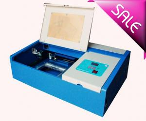 China Co2 Mini Laser Cutting And Engraving Machine For Leather With 300 X 200mm Working Size on sale