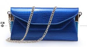 China shinny patent leather crocodile embossed clutches with metal strap on sale