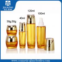 Color-Coating Yellow Cosmetic Glass Bottles ,  Empty Lotion Bottles  With Plastic Pump Cap