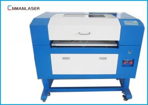 China Small Size 6040 60w Stamp Rubber Mini Laser Engraving Cutting Machine Price on sale