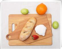 China Hot-Selling Vegetable Bamboo Cutting Board with Handle on sale