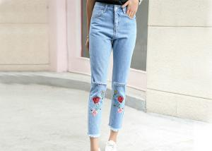 China Quick Dry Flower Embroidered Jeans 75d Light Blue Ripped Jeans Washed on sale