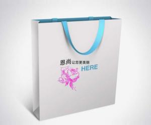 China Customized Handle Black Gift Kraft Paper Bag with Design Stamping Logo on sale