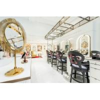 Luxury fashion Makeup store interior fit outs by wooden Ivory counters with Bronzed metal craft display Showcase
