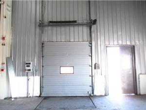 China Galvanized Steel Exterior Industrial Sectional Doors Opening Speed 1.0m/s on sale