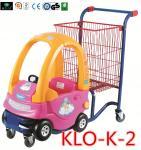 Красный порошок покрыл нажимать магазинные тележкаи малышей с автомобилем игрушки/вагонеткой покупкы для малышей