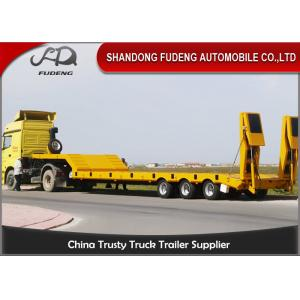 China Triple Axle 80 Ton Low Bed Semi Trailer With Hydraulic Ladder For Transport Heavy Machine on sale