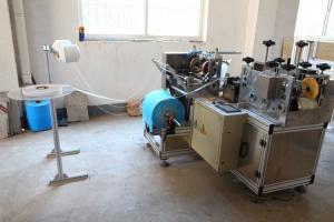 China PlastIc Shoe Cover Making Machine 3 KW ALT-PE400 60 Pcs/Min With Nonwoven Strip on sale