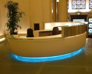 China Bespoke Millwork reception counter in Pure white painting by tempered glass top with LED inside lighting on sale