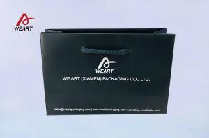 China Special Customized Paper Bag Blue Color Embossed Logo With Blue Handle on sale