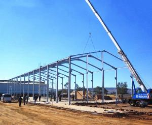China Light Steel Frame Structure Metal Warehouse Buildings Steel Construction Materials on sale