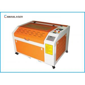 China 6040 Mini Portable Wood Acrylic Rubber Stamp CO2 60W Laser Cutting And Engraving Equipment on sale