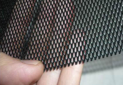 A Piece Of Black Powder Coated Aluminum Expanded Security Window Screen In  A Manu0027s Hand
