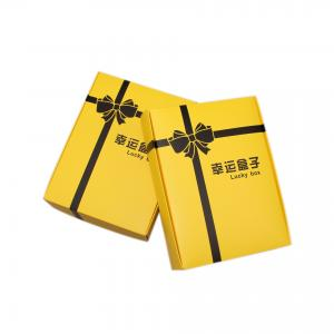 China Folding ivory paper color printing yellow Lucky box customized on sale