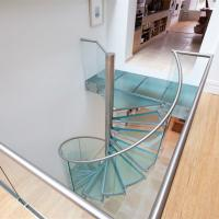 China Interior spiral staircase prices with stainless steel stair railing on sale
