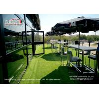 Black double decker tent for large and luxury event.