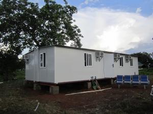 Quality モジュラー携帯用緊急の避難所は、Foldable プレハブの家/タイルを波形を付けました for sale