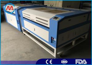 China Digital CNC Co2 Wood Laser Engraving Machine , Stepper Motor Portable Laser Etcher on sale